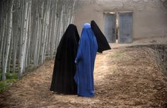 Afghan women walk outside a house near the DHQ (Char Dara District Police Headquarters) in the province of Kunduz, March 29, 2012. (Johannes Eisele/AFP/Getty Images)