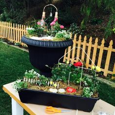 Plant a miniature rose garden in a container using repurposed bottles and flowers from the grocery store!