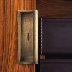 Rosewood, brass, leather stitching