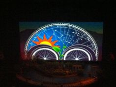 Projection on scrim with choreographed performers.
