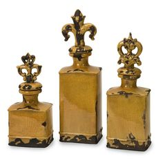 Canary Yellow Ceramic Bottles with Finials - Set of 3 - Clean, square shapes showcase the rich yellow crackle glaze of this collection. Topped with fleur de lis finials, the Canary bottles bring an updated look to old world charm. Set of three.