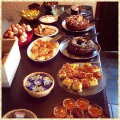 Traditional Greek breakfast with pies, cakes and organic marmalades at the most romantic hotel on Aegina Island, Greece...