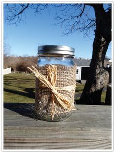 Mason jar wrapped in burlap, with a candle inside. Exactly what I want to do for centerpieces, but I want to make a sailor's knot around the burlap instead of just a bow