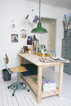 wooden work table and green lamp.