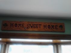 Home sweet Home sign over the bay window - Burned the letters into the wood with a dremel tool and then stained & painted.  Great weekend project.