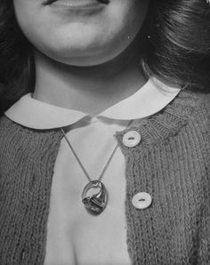 Going steady, signified by wearing her boyfriend's ring around her neck