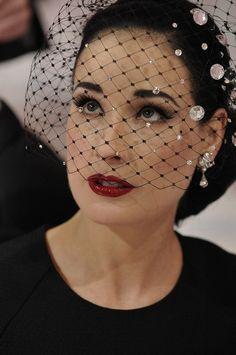 Dita Von Teese; love the crystals on her birdcage
