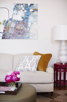 English roll arm sofa and abstract art in Lauren McGrath's studio apartment