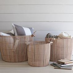 wood baskets.  maybe my cat wouldn't scratch these as much as rattan?