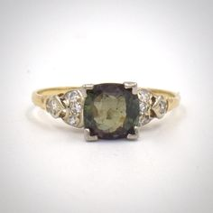 SOLD: A rare and delightful natural alexandrite engagement ring boasts a round cut alexandrite weighing 1.80 carats.