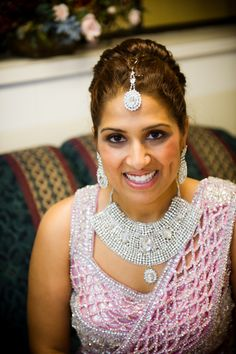 23n indian wedding bridal reception pink sari and jewelry. More here: http://www.indianweddingsite.com/multicultural-fusion-wedding-kellie-sanders-photography/