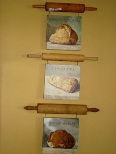 Hang artwork from rolling pins...fab idea for kitchen art display