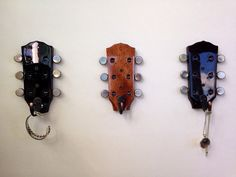Broken guitar headstocks repurposed into coat hooks for:  coats, hats, jewelry, kitchen utensils, backpacks, keys, purses, and so much more.  Come visit our store for more unique home decor items and art at www.MusicAsArtBySarah.etsy.com
