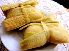 Humitas ... One of my favourite Chilean foods, its fresh corn with chopped onion and basil made to a paste. The paste is wrapped in tender leaves of corn (cob) and cooked in salted water. Open up & sprinkle with salt or sugar! Mmmmm