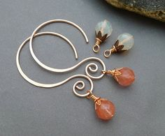These large ear wires are hand formed from 18 gauge copper wire, which is a bit thicker than average earring size. They come with two sets of bead