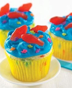 """Aqua Blue Seaside Cupcakes from Pillsbury® Baking are great for an under-the-sea themed kids birthday party! Create """"waves"""" with the frosting by pulling your knife quickly away from the surface. Fishing Cupcakes, Beach Cupcakes, Summer Cupcakes, Kid Cupcakes, Swim Party Cupcakes, Ocean Theme Cupcakes, Swimming Cupcakes, Pool Party Treats, Kids Birthday Cupcakes"""