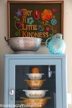 Vintage style - love the Pyrex mixing bowls and the embroidered art eclecticallyvintage.com #EclecticallyFall