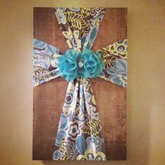 Fabric cross on wood.