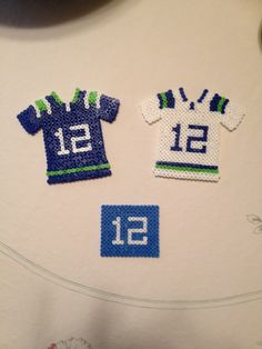 Perler bead Seahawks jerseys. These would make awesome fridge magnets