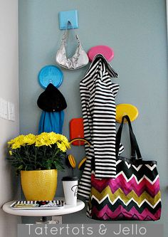 Get Organized for Back to School by Making these fun and bright entryway hooks!! -- Tatertots and Jello