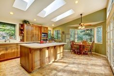 Large green country kitchen with skylights and wood cabinets. Green Country Kitchen, Country Kitchen Designs, Modern Kitchen Design, Residential Skylights, Modern Sink, Remodeling Contractors, Wood Cabinets, New Homes, Kitchen Remodeling