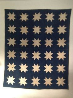 Nice indigo blue and early white shirtings make this quilt, late 1880s and in pretty nice condition as you can see.  There is a brown stain, and two small holes, but even hanging it is a stunning piece, and folded - it is perfect.  Quilt measures 63 x 79  Price $ 125.00