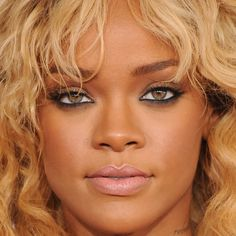 Newly blond Rihanna amped up the sex appeal with superdefined eyes and pale pink lipstick.