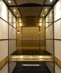Brass trims, support bands, and a suspended ceiling makes this elevator interior a jewel in the heart of a historic Montréal building. Stair Lift, Stair Railing, Stairs, Elevator Design, Elevator Lobby, Halls, Lift Design, Interior Architecture, Interior Design