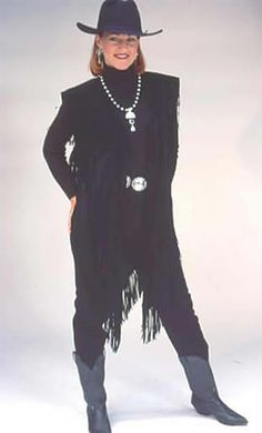 Long black velvet western vest lavished with rows of fine Ultrasuede or Rayonfringe. This is perfect for a Formal Western Wear 0r a Special occasion. The southwestern jewelry and the Western Hat along with the concho belt completes the look. 100% Cotton. Dry Clean.
