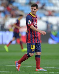Lionel Messi looks on during the La Liga match between UD Almeria and FC Barcelona on September 28, 2013 in Almeria, Spain.