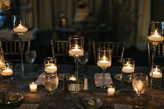 Add shimmer and shine to any estate table with floating candles at varying heights. Wedding Ceremony, Reception, Grand Hyatt, Centerpieces, Table Decorations, Shimmer N Shine, White Lilies, Floating Candles, Wedding Table Settings