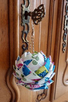 fabric ball  Alternative: oval ball, green/brown fabric = pinecone ornament  (hang upside down)