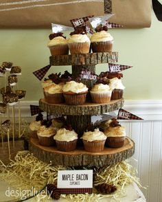 maple bacon cupcakes + a log tree cake stand. have smash cake for E and cupcakes for guests