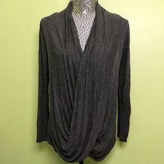 I just added this to my closet on Poshmark: Dark Gray Loose Drape Wrap Front Top. Price: $5 Size: M  #poshmark #shopmycloset #rabbitss #fashion #shopping #style #forsale #top #longsleeve #wrap