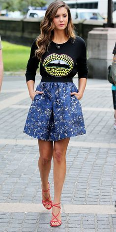 Nina Dobrev is stunning in this graphic lip sweater and patterned blue skirt. // #Fashion