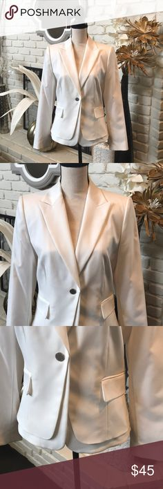 Calvin Klein white jacket!! Fabulous jacket!  Timeless and sophisticated!  One button closure with tuxedo style collar.  Two front pockets.  Flattering cut.  Comes with additional buttons in packet.  Substantial weight to fabric.  100% polyester.  Never been worn in excellent condition! Calvin Klein Jackets & Coats Blazers