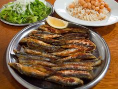 Hamsi Tava - Fried anchovies. When served with arugula and lemon, anchovies lose their distinct fishy taste and instead taste more similar to fresh fish and chips.
