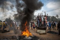 Demonstrators gather on a street in Bangui, Central African Republic, November 17, 2013, to call for the resignation of interim President Mi...