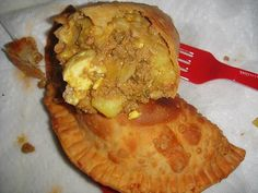 Empanadas Dominicanas- Its basically fried dough with stuffing in it, for our culture usually chicken or beef with cheese, or cheese alone. When done right, they do take a bit of time to make, if anyone makes you these from scratch, they love you very much, although due to the popularity of the product they are even sold frozen, so all you have to do is throw it in the oven or hot oil to fry to make them, there is nothing like the home made stuff when it comes to Dominican Foods.
