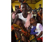 Mother and her two children at one of Mercy Hospital's outreach clinics