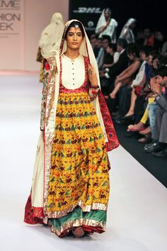 traditional designs fused with khadi with parsi embroidery and zardosi work,