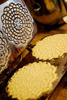 Italian Pizzelles. My pizzelle iron looks like this. It was my mom's, its over 50 yrs. old. I make pizzelles every Christmas. Stacks and stacks of them!