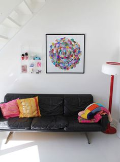 Great color - love the circle artwork and the little plastic curio with knick-knacks hanging on the wall.  So fun!
