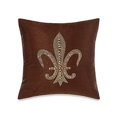 Sophisticated and elegant, this Fleur De Lis jeweled Throw Pillow adds a luxurious touch wherever you place it. Plush velvet is embroidered with the fleur de lis design, then bedazzled with shimmering stones.