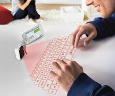 Keychain Laser Virtual Keyboard   DudeIWantThat.com