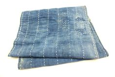 Japanese antique boro textile of early 1900s. Artisan made. This was a sleeve of a garment and is made up of two