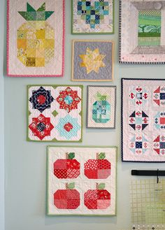 Wall of mini quilts from A Bright Corner