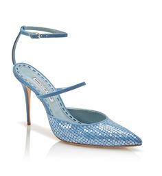 The denim-driven collection, Rihanna x Manolo Blahnik, will debut May 5. It features sequins and embroidery influenced by Rihanna's hand tattoos. They appear on designs including thigh-high boots and an open-toe sandal