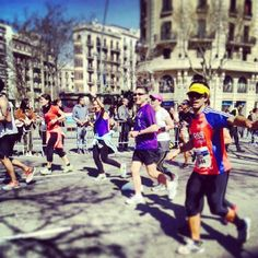Barcelona 2014 Marathon.  I only ran half , but it was an incredibly exciting way of exploring the city.