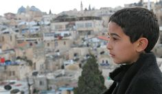Nine-year-old Ayman, a Palestinian, lives in the densely populated Muslim Quarter of East Jerusalem, in the West Bank. He takes Judo classes at the Abna Al-Quds community centre which is located next to the Old City Wall. The centre is one of two in the neighbourhood that is supported by UNICEF, offering a rare public space for children and adolescents to play and interact safely. - © UNICEF/NYHQ2012-0298/Giacomo Pirozzi - www.unicef.org/...